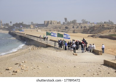 Travellers in Caesarea Maritima in Israeli Coastal Plain, Holy Land