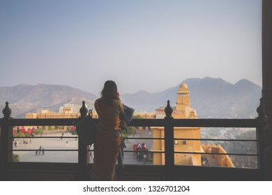 Travellers enjoy beautiful view point of Amber Palace, Jaipur, Rajasthan - India
