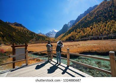 Travellers trekking in Yading Natural Reserve, Daocheng , Sichuan - China