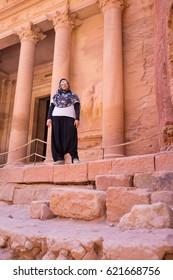 Travellers visiting Petra in Jordan during summer trip