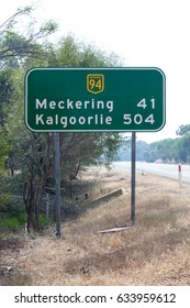Travelling along the Great Eastern Highway passing an Australian road sign indicating 504 kilometres until reaching Kalgoorlie, a mining town in Western Australia.