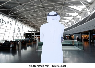 Travelling Arabic man thinking while inside airport wearing traditional kandora thawb menswear