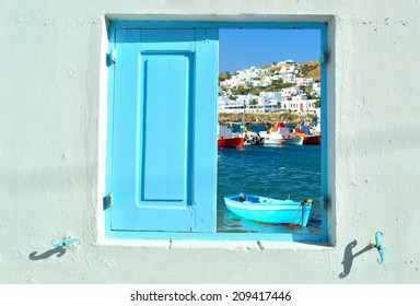Travelling concept - window into beauty of Greece and Cyclades islands showing old port of Mykonos and colorful boats