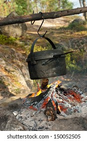 Travelling cooking - kettle over camping fire