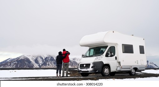 Travelling couple with Mobile motor home RV campervan driving through Iceland in recreational vehicle, freedom vacation motorhome lifestyle