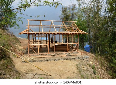 Travelling in Nepal: building a house, near Taplejung, Kanchenjunga trek.