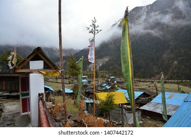 Travelling in Nepal: forests, paths, buildings, bridges near Ghunsa village, Kanchenjunga trek.