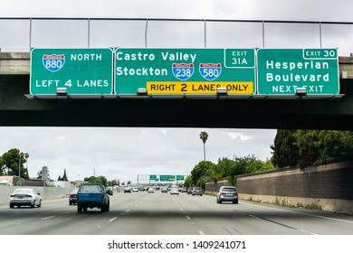 Travelling on the freeway through Hayward towards Oakland and approaching the Castro Valley / Stockton junction; East San Francisco bay area, California