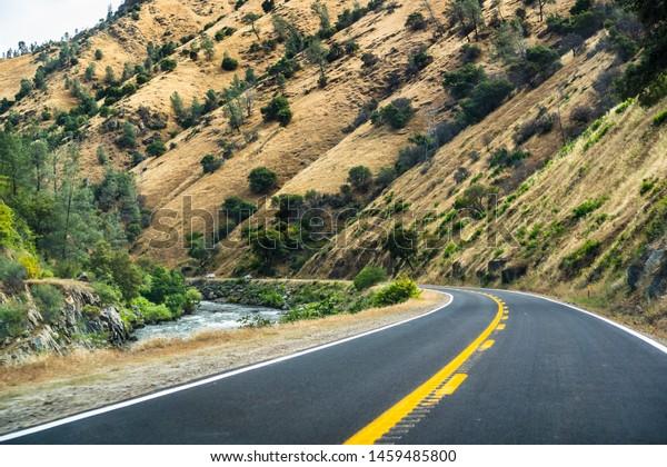 Travelling on Highway 140 along Merced river towards Yosemite National Park, Mariposa county, California