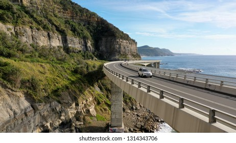 Travelling on the sea cliff bridge coastal drivel along the pacific ocean. Grand pacific drive, East coast of Australia. Clear sunny day.