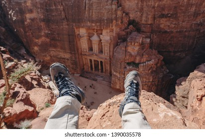 Travelling in Petra, the rose city in Jordan. Traveler enjoying high angle view of ancient architecture and landmark of Middle East in Petra, Jordan