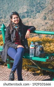 Travelling Portrait of a happy young mature asian girl with travel accessories. Happy asian woman travelling photo. Nepali Tourist woman
