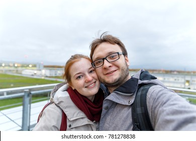Travelling young couple take the selfie shot, smiling and happy, in the sport style clothes and backpack