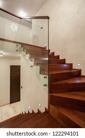 Travertine house - Wooden glass staircase in modern interior