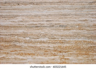 Travertine stone slab panel with natural veining pattern