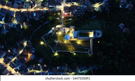 Travnik, Bosnia-Herzegovina, 7.6.2019. Travnik's castle with its neighbourhood at night, top-down view at