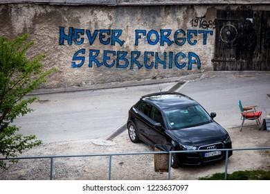 Travnik, Central Bosnia Canton  /  Bosnia and Herzegovina - 04.27.2014: inscription on a wall in the Travnik city, Bosnia, about Srebrenica massacre