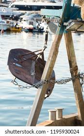 Trawl doors, otter boards, on a Mediterranean fishing trawler boat, moored