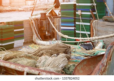 Trawl, pelagic boards, fishing net and boxes for fish lies on the fishery deck of a small fishing seiner