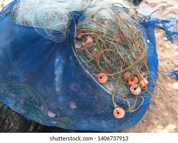 Trawls of fisherman are in the blue bag at beach.