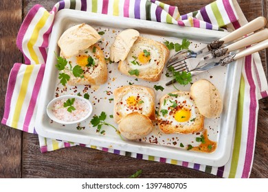 Tray of baked eggs in crunchy bread rolls