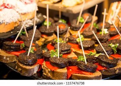 Tray with black pudding skewers and peppers in a bar in Bilbao, Spain