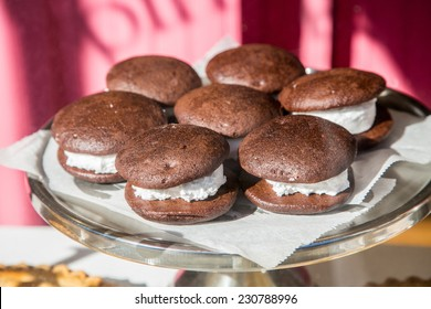 A tray of chocolate whoopie pies in a window display in Maine