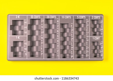Tray for counting euro coins isolated on neutral color background