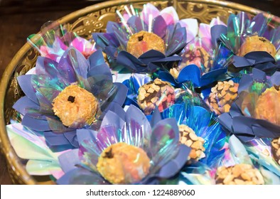 Tray decorated with chocolate candy with peanuts and coconut candy