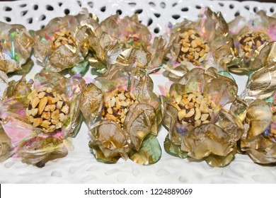 Tray decorated with chocolate candy and peanuts