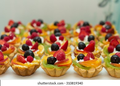 Tray with delicious cakes. Elegant sweet table with big cake, cupcakes, cake pops on dinner or event party. Cake pops. Tray with delicious cakes