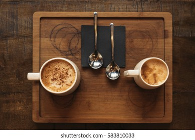 Tray with delicious coffees in the bar.