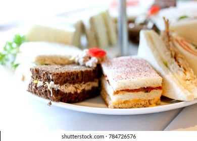 a tray of delicious finger food sandwiches