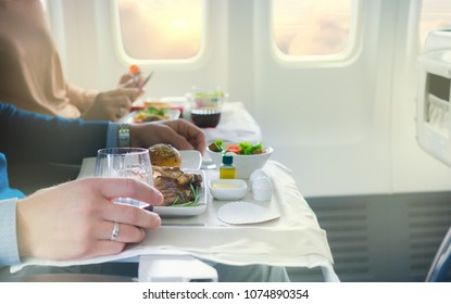 Tray with delicious food on the plane, business class travel.