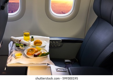 Tray of food on the airplane, business class