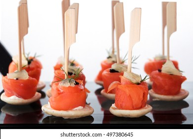 Tray food Salmon rolls canape on slate platter