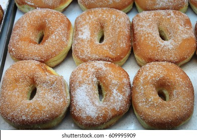 Tray of fresh doughnuts sold in a patisserie