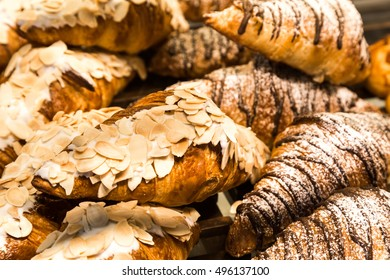 Tray of freshly baked gluten free croissant with Almond toping