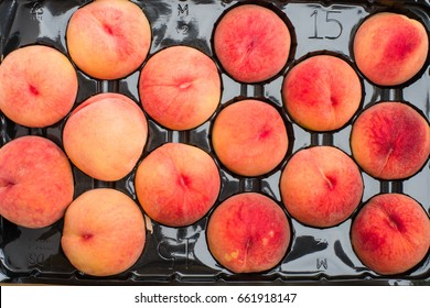 Tray of freshly harvested yellow peaches