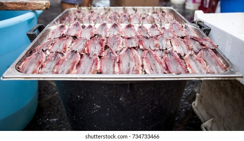 a tray full of spun sardines sold in a fishmarket in Catania