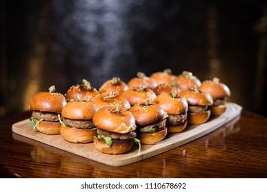 Tray of gourmet mini beef burgers in brioche buns