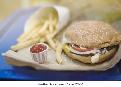 tray of hamburger and fries with ketchup, american food background.