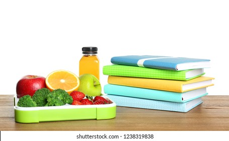 Tray with healthy food and notebooks on table against white background. School lunch