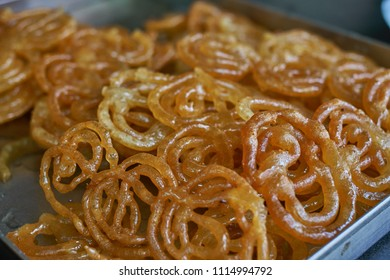 A tray of Indian Jalebi, a very sweet dessert.