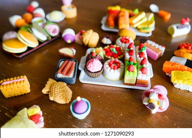 A tray of miniature dessert erasers, with other trays with food erasers in the back.
