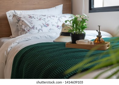 tray of plant and coffee cup with hat on classic bed, interior design decoration concept