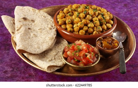 TRAY PLATTER WITH CHICKPEA CURRY OR CHANNA MASALA,CHAPATTI BREAD,CHOPPED TOMTAO SALAD AND CHUTNEY