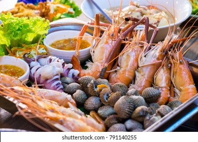 Tray of prawns, squids and clams with spicy and sour dipping sauce that is packed full of Thai seafood flavour.