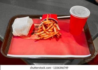 Tray served  with burger soda and fries at a fast food restaurant