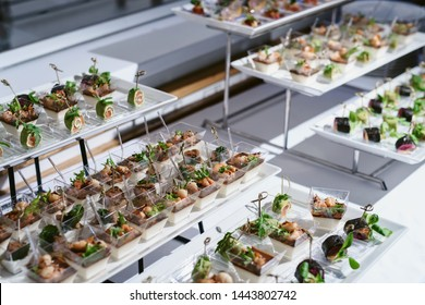 Tray of snacks at a banquet or reception. Catering buffet at party. Buffet table welcome drink concept